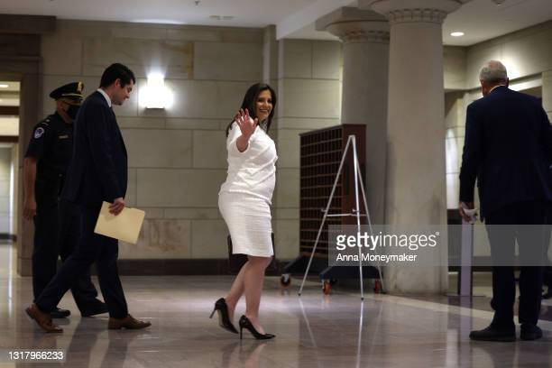 Rep. Elise Stefanik waves as she arrives at a caucus meeting where Republican members will vote on a replacement for Rep. Liz Cheney as Chair of the...