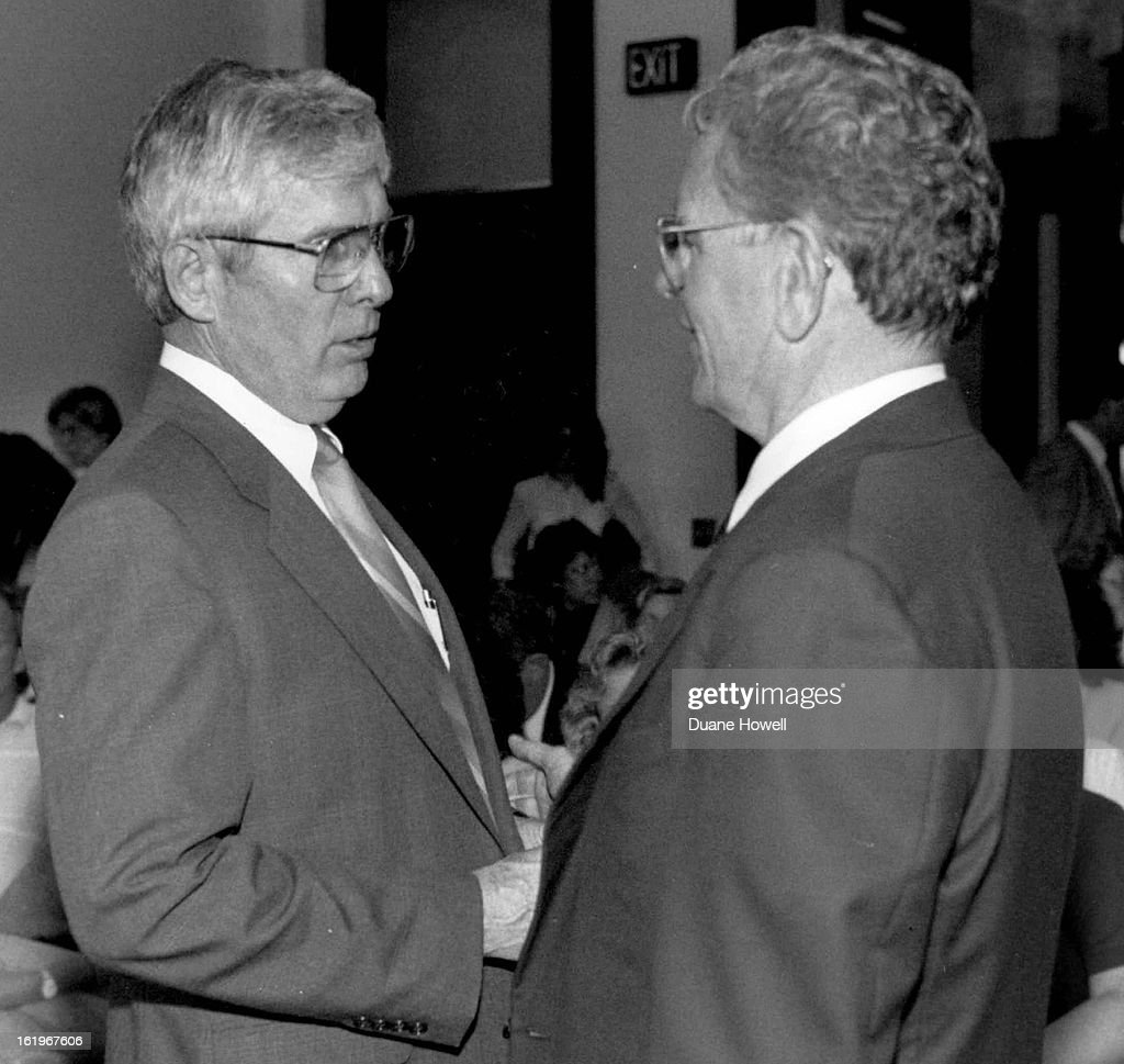 5-1988; Rep. Elwood Gillis the chairman of the JBC talks with Gov. Roy Romer during hearing with nur : News Photo