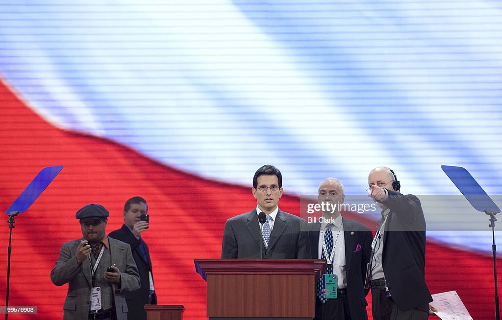Rep. Eric Cantor, R-Va., familiarizes himself with the podium and teleprompters during his walk through on floor of the Republican National Convention at the Excel Center in St. Paul, Minn., on Monday, Sept. 1, 2008.