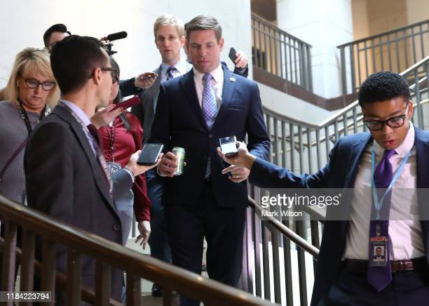 Rep Eric Swalwell is trailed by reporters as he walks to a closeddoor deposition on Capitol Hill October 29 2019 in Washington DC Army Lt Col...
