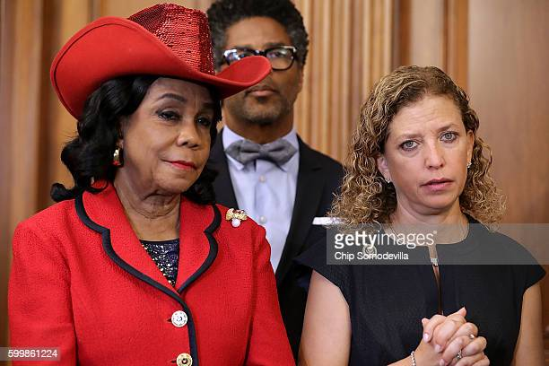 Rep Frederica Wilson and Democratic National Committee Chair Rep Debbie Wasserman Schultz join fellow Democratic members of the House for a news...