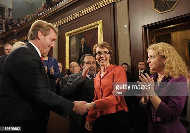Rep. Gabrielle Giffords is greeted by Rep. Jeff Flake and Rep. Debbie Wasserman-Schultz before the State of the Union address before a joint session...