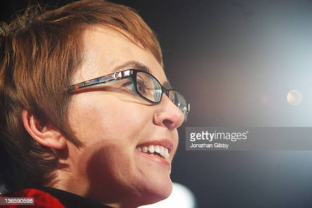 "Rep. Gabrielle Giffords smiles during the ""Remembering January 8th Candlelight Vigil"" held at the University of Arizona Mall January 8, 2012 in..."