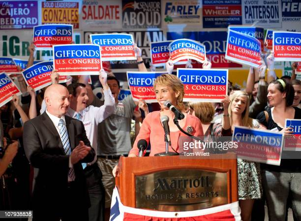 Rep. Gabrielle Giffords speaks on election night at Democratic Election Headquarters as her husband Mark Kelly applauds at the Tucson Marriott...