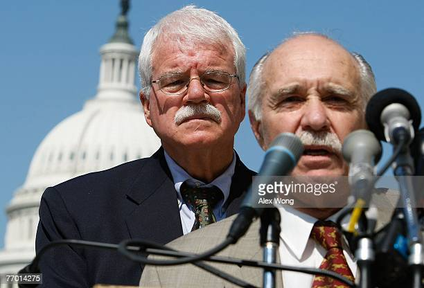 S Rep George Miller listens as Rodger Schlickheisen president of the Defenders of Wildlife speaks during a news conference to introduce the 'Protect...