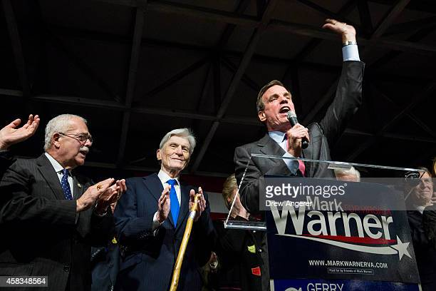 S Rep Gerry Connolly and former US Senator John Warner look on as Sen Mark Warner speaks during a Get Out the Vote rally for Democratic candidates...