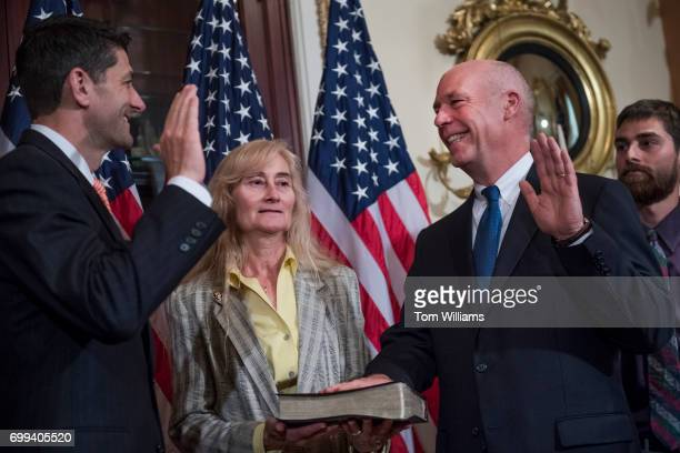 Rep Greg Gianforte RMont and his wife Susan participate in a swearing in ceremony in the Capitol with Speaker Paul Ryan RWis before the actual event...