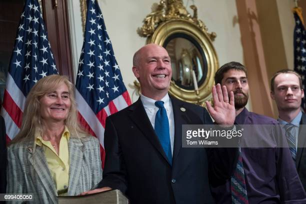 Rep Greg Gianforte RMont his wife Susan and sons participate in a swearing in ceremony in the Capitol with Speaker Paul Ryan RWis before the actual...
