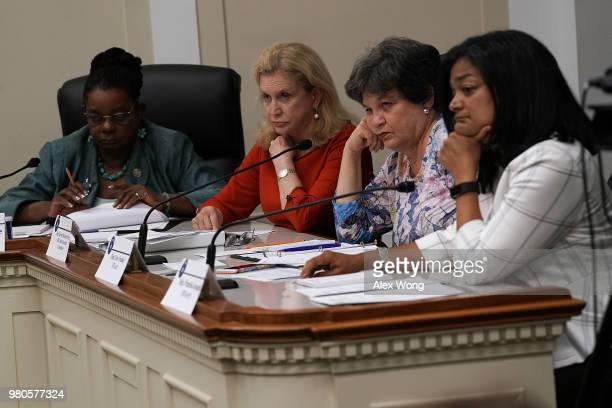 "Rep. Gwen Moore , Rep. Carolyn Maloney , and Rep. Lois Frankel , and Rep. Pramila Jayapal listen during a ""shadow hearing"" before the Democratic..."