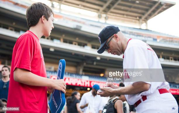 Rep Hakeem Jeffries DNY gives an autograph before the start of the annual Congressional Baseball Game at Nationals Park in Washington on Thursday...