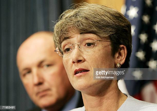 Rep Heather Wilson speaks with Rep Pete Hoekstra chairman of the House Intelligence Committee during a news conference on the FISA surveillance bill...