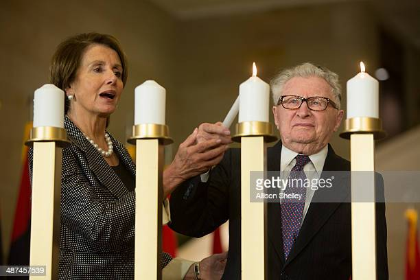Rep House leader Nancy Pelosi and Holocaust survivor Irving Holt light one of six official candles at the National Commemoration of the Days of...