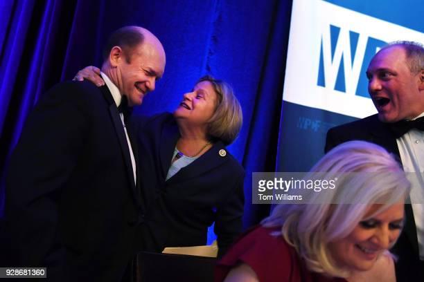 Rep Ileana RosLehtinen RFla greets Sen Chris Coons DDel as House Majority Whip Steve Scalise RLa looks on during the Washington Press Club...