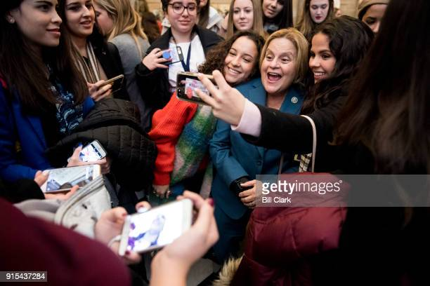Rep Ileana RosLehtinen RFla poses for selfies in Statuary Hall with female students touring the Capitol as part of the Closeup Foundation program on...