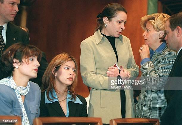Rep. Ileana Ros-Lehtinen speaks with the daughter of Cuban President Fidel Castro, Alina Fernandez, as Marisleysis Gonzalez and Georgina Cid, both...