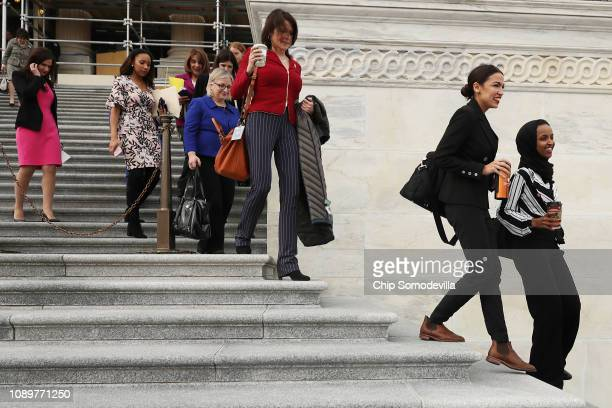 Rep Ilhan Omar and Rep Alexandria OcasioCortez join their fellow House Democratic women for a portrait in front of the US Capitol January 04 2019 in...