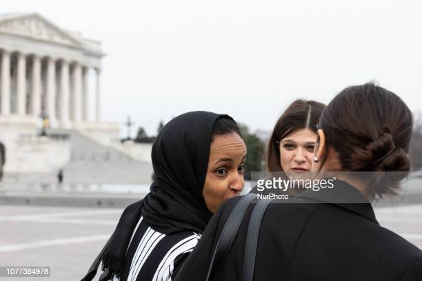 Rep Ilhan Omar and Rep Alexandria OcasioCortez make their way to take a group photo with Speaker Nancy Pelosi and fellow House Democratic women in...