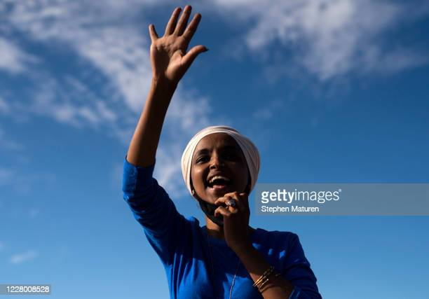 Rep Ilhan Omar campaigns at the intersection of Broadway Avenue and Central Avenue on August 11 2020 in Minneapolis Minnesota Omar retained her seat...