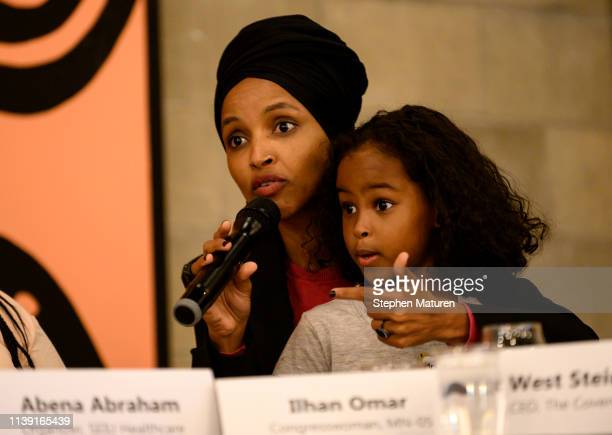 Rep. Ilhan Omar holds her daughter Ilwad during a town hall meeting on gender pay gap and equity at La Doña Cerveceria on April 24, 2019 in...