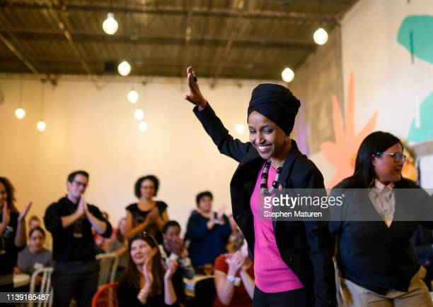 Rep. Ilhan Omar is introduced on stage at a town hall meeting on gender pay gap and equity at La Doña Cerveceria on April 24, 2019 in Minneapolis,...