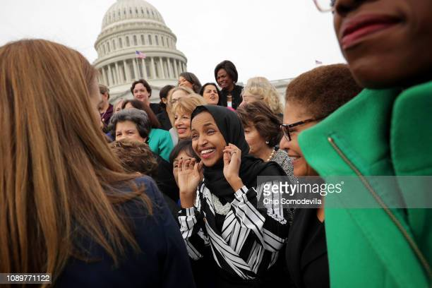 Rep Ilhan Omar joins her fellow House Democratic women for a portrait in front of the US Capitol January 04 2019 in Washington DC The 116th Congress...