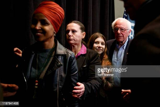 Rep Ilhan Omar left walks ahead of Democratic presidential candidate Sen Bernie Sanders after delivering remarks at a campaign event at Simpson...