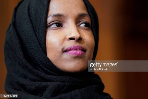 Rep Ilhan Omar listens as lawmakers speak about the Voting Rights Enhancement Act HR 4 on Capitol Hill on February 26 2019 in Washington DC