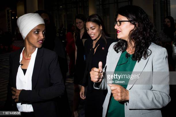 Rep. Ilhan Omar , Rep. Alexandria Ocasio-Cortez and Rep. Rashida Tlaib arrive before participating during a town hall hosted by the NAACP on...