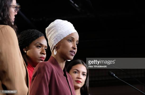 S Rep Ilhan Omar speaks as Rep Rashida Tlaib Rep Ayanna Pressley and Rep Alexandria OcasioCortez listen during a press conference at the US Capitol...