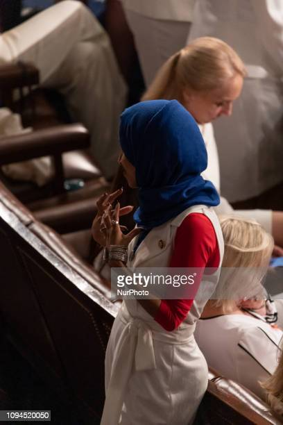 Rep Ilhan Omar talks to fellow members before US President Donald Trump's second State of the Union address to a joint session of Congress at the US...