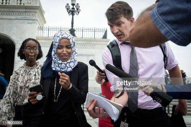 Rep. Ilhan Omara speaks to a reporter as she walks down the steps of the Capitol building after voting for a resolution denouncing comments by...