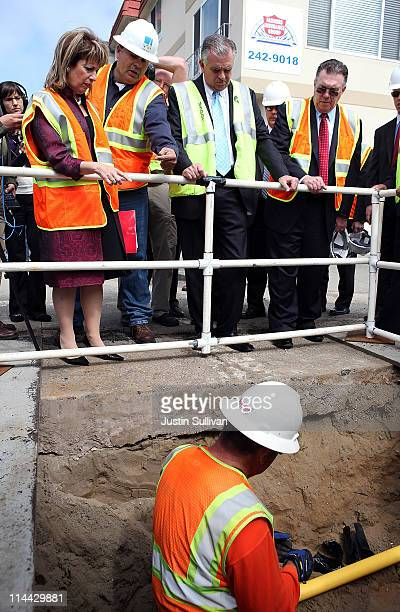 US Rep Jackie Speier Pacific Gas and Electric worker Rick Salaz US Transportation Secretary Ray LaHood and San Bruno mayor Jim Ruane watch a worker...