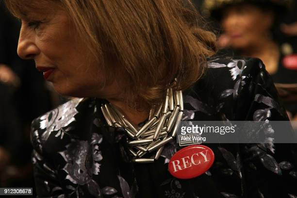 S Rep Jackie Speier wears black with a 'Time's Up' pin and a 'RECY' button as she participates in a photoop at the US Capitol prior to President...