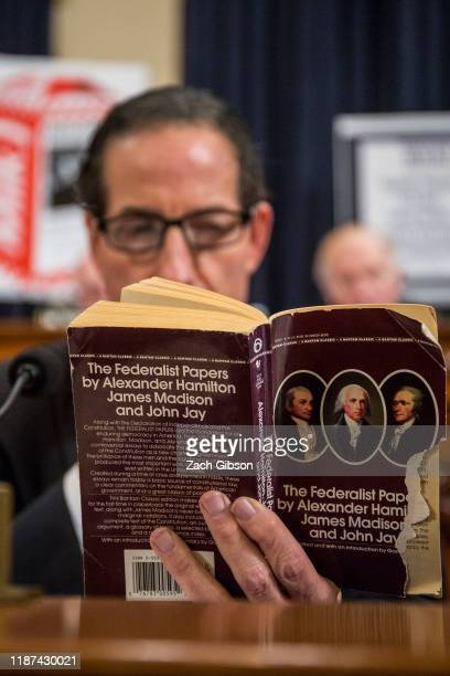 Rep. Jamie Raskin reads a copy of The Federalist Papers during a House Judiciary Committee hearing questioning staff lawyer Stephen Castor,...