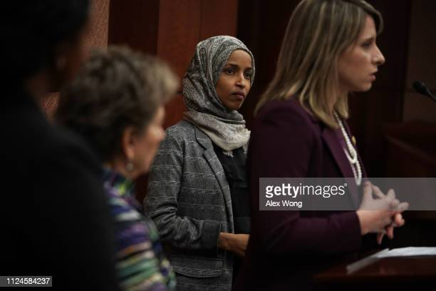 US Rep Jan Schakowsky and Rep Ilhan Omar listen as Rep Katie Hill speaks during a news conference January 24 2019 on Capitol Hill in Washington DC...