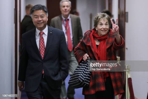 Rep Jan Schakowsky flashes a victory sign as she and Rep Ted Lieu arrive for a Democratic caucus meeting in the US Capitol Visitors Center November...