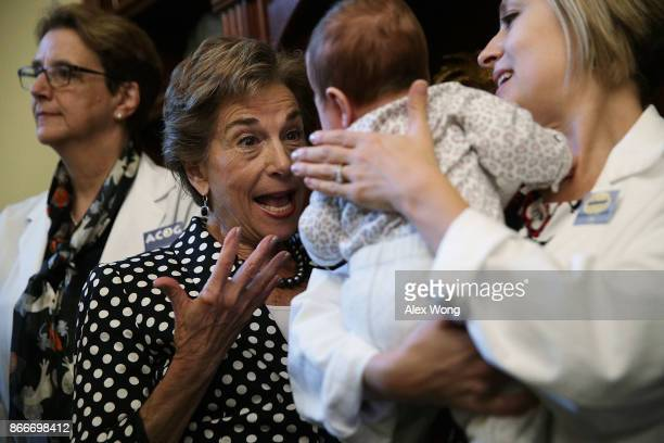 S Rep Jan Schakowsky plays with threemonthold Zadie Miller as her mother Sarah Horvath an MD with Physicians for Reproductive Health looks on during...