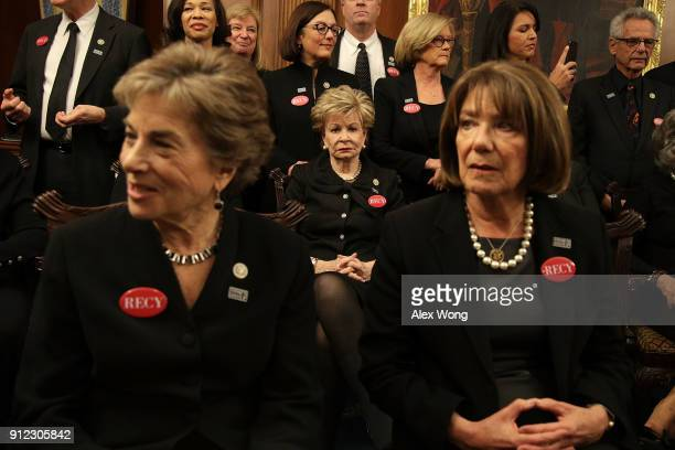 US Rep Jan Schakowsky Rep Madeleine Bordallo Rep Susan Davis and other House Democrats wear black as they participate in a photoop at the US Capitol...