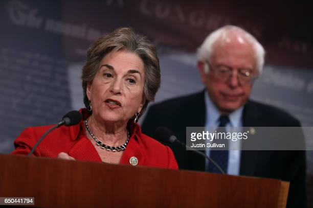 S Rep Jan Schakowsky speaks during a news conference as US Sen Bernie Sanders looks on at the US Capitol on March 9 2017 in Washington DC Sen Bernie...