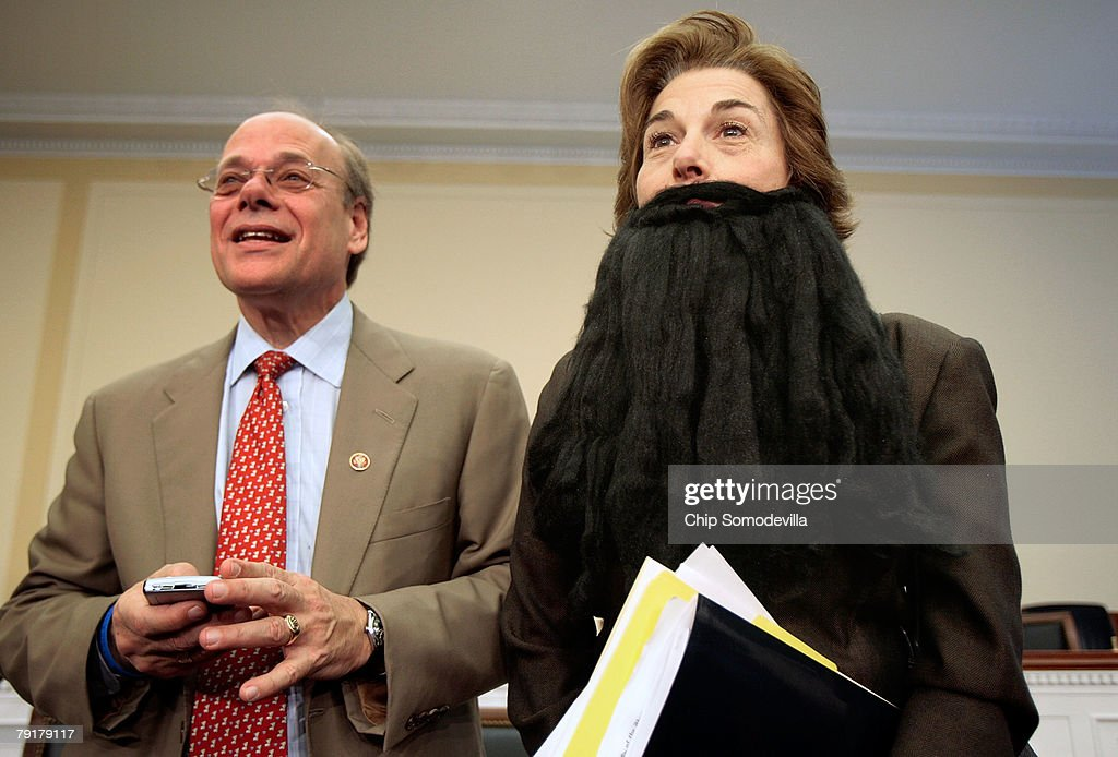 Rep. Jan Schakowsky (D-IL) (R) wears a fake beard to show solidarity with striking members of Writers Guild of America during a comedic mock debate and news conference about the strike with Rep. Steve Cohen (D-TN) on Capitol Hill January 23, 2008 in Washington, DC. Members of Congress met with representatives of the WGA to talk about their current strike over the minimum basic agreement which sets the amount that companies must pay writers for the use and reuse of their work.