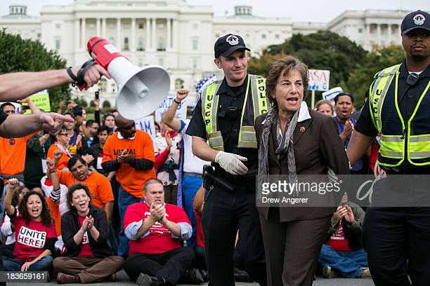 Rep Janice Schakowsky is arrested by US Capitol Police after blocking First Street NW in front of the US Capitol with fellow supporters of...
