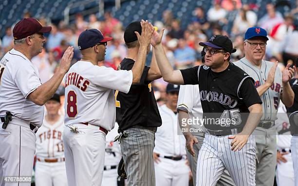 Rep Jared Polis DColo gets highfives from his fellow Democrats during player introductions at the 54th Annual Roll Call Congressional Baseball Game...