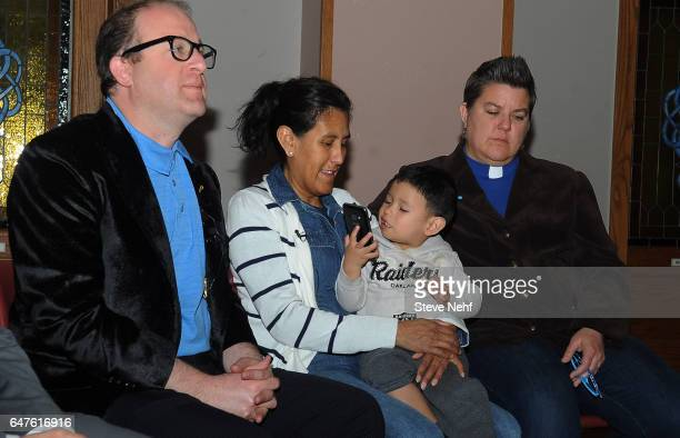 S Rep Jared Polis speaks to press along with Jeanette Vizguerra holding her grandson Santiago Tabulla and Reverend Anne Duncan right Wednesday March...