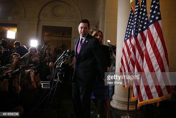 S Rep Jason Chaffetz and his wife Julie approach the podium to speak to members of the media after a closed House Republican election meeting to pick...