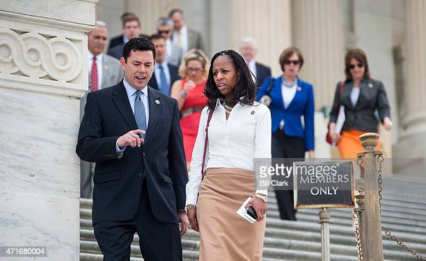 Rep Jason Chaffetz RUtah left and Rep Mia Love RUtah talk as they walk down the House steps following votes in the US Capitol on Thursday April 30...