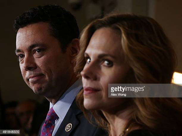 S Rep Jason Chaffetz speaks to members of the press as his wife Julie looks on after a closed House Republican election meeting to pick the next GOP...