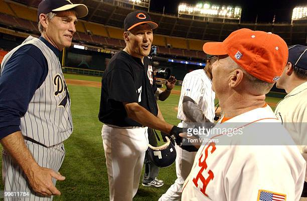 Rep Jay Inslee DWash center congratulates Rep Kevin Brady RTexas after the 44th Annual Roll Call Congressional Baseball Game at RFK Stadium in...