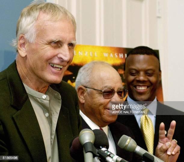 Rep JC Watts Jr looks on as former Alexandria Virginia high school foootball coaches Bill Yoast and Herman Boone discuss the Walt Disney Company's...