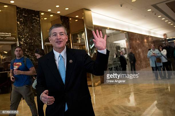 Rep Jeb Hensarling chairman of the House Financial Services Committee waves after speaking to the press in the lobby at Trump Tower November 17 2016...