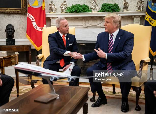 US Rep Jeff Van Drew of New Jersey who has announced he is switching from the Democratic to Republican Party shakes hands with US President Donald...